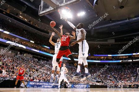 Anthony Barber, Phil Booth, Daniel Ochefu North Carolina State's Anthony Barber (12) shoots between Villanova's Phil Booth (5) and Daniel Ochefu, right, during the second half of an NCAA college basketball tournament Round of 32 game in Pittsburgh, . NC State won 71-68