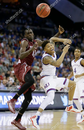 Kelly Oubre Jr., Pascal Siakam New Mexico State forward Pascal Siakam, left, fights for a loose ball with Kansas guard Kelly Oubre Jr. during the second half of an NCAA tournament college basketball game in the Round of 64, in Omaha, Neb. Kansas won 75-56