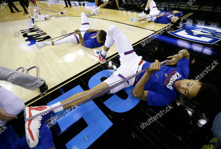 Kelly Oubre Jr Kansas guard Kelly Oubre Jr., right, stretches with teammates before an NCAA tournament college basketball game against New Mexico State in the Round of 64, in Omaha, Neb