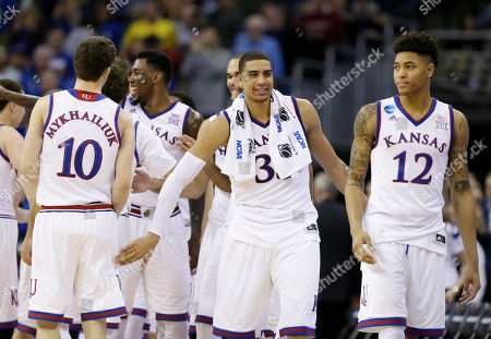 Landen Lucas, Kelly Oubre Jr Kansas' Landen Lucas, center, and Kelly Oubre Jr., right, react after an NCAA tournament college basketball game against New Mexico State in the Round of 64, in Omaha, Neb. Kansas won 75-56