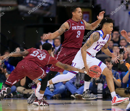 Daniel Mullings, Kelly Oubre Jr., Remi Barry Kansas' Kelly Oubre Jr. (12) drives past New Mexico State's Remi Barry (3) and New Mexico State's Daniel Mullings (23) during the first half of an NCAA tournament college basketball game in the Round of 64 in Omaha, Neb