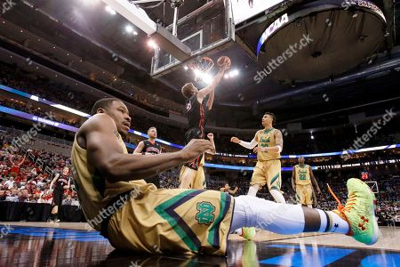Demetrius Jackson, Scott Eatherton Notre Dame's Demetrius Jackson, front, rolls on the floor after trying to stop Northeastern's Scott Eatherton (43) who shoots during the second half of an NCAA tournament second round college basketball game, in Pittsburgh