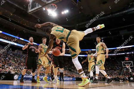 Demetrius Jackson, Scott Eatherton Notre Dame's Demetrius Jackson (11), tumbles to the floor after trying to stop Northeastern's Scott Eatherton (43) who shoots during the second half of an NCAA tournament second round college basketball game, in Pittsburgh