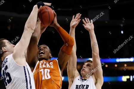 Jonathan Holmes Texas's Jonathan Holmes (10) plays against Butler during the first half of an NCAA tournament second round college basketball game, in Pittsburgh