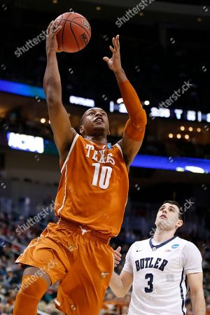 Jonathan Holmes, Alex Barlow Texas's Jonathan Holmes (10) shoots past Butler's Alex Barlow (3) during the first half in the second round of the NCAA college basketball tournament, in Pittsburgh