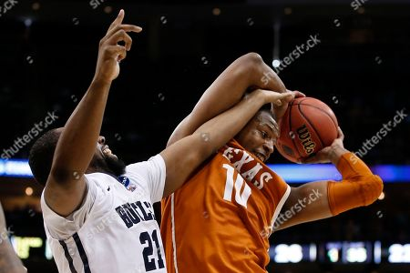 Jonathan Holmes, Roosevelt Jones Texas's Jonathan Holmes (10) grabs a rebound in front of Butler's Roosevelt Jones (21) during the first half of an NCAA tournament second round college basketball game, in Pittsburgh
