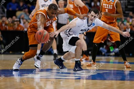 Jonathan Holmes, Alex Barlow Texas's Jonathan Holmes, left, steals the ball from Butler's Alex Barlow (3) during the first half of an NCAA tournament second round college basketball game, in Pittsburgh