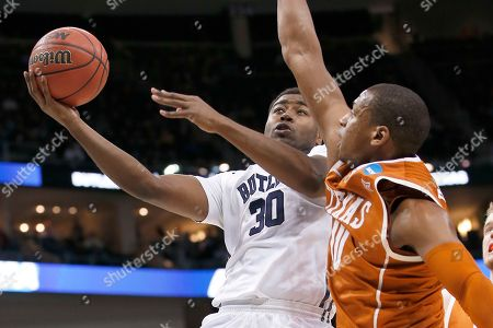 Kelan Martin, Jonathan Holmes Butler's Kelan Martin (30) shoots over Texas's Jonathan Holmes (10) during the second half in the second round of the NCAA college basketball tournament, in Pittsburgh