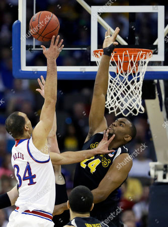 Perry Ellis, Shaquille Morris Kansas forward Perry Ellis, left, shoots over Wichita State forward Shaquille Morris, right, during the first half of an NCAA college basketball tournament Round of 32 game, in Omaha, Neb