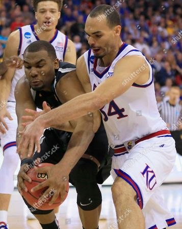 Shaquille Morris, Perry Ellis Wichita State's Shaquille Morris, front left, and Kansas' Perry Ellis, right, chase the ball during the second half of an NCAA tournament college basketball game in the Round of 32 in Omaha, Neb