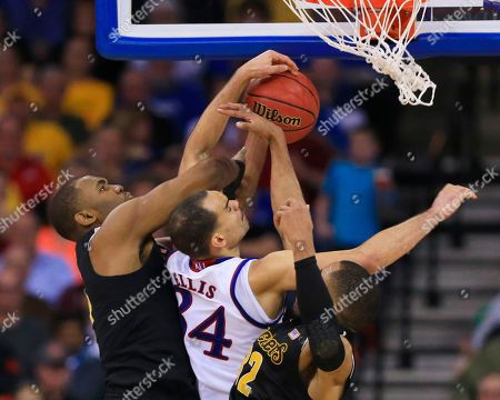 Shaquille Morris, Tekele Cotton, Perry Ellis Wichita State's Shaquille Morris, left, and Tekele Cotton (32) block Kansas' Perry Ellis (34) during the second half of an NCAA tournament college basketball game in the Round of 32 in Omaha, Neb