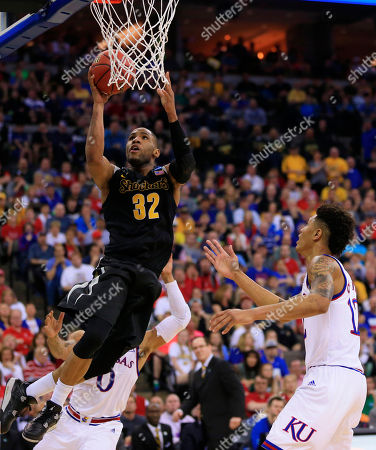 Stock Photo of Tekele Cotton, Kelly Oubre Jr., Frank Mason III Wichita State's Tekele Cotton (32) shoots over Kansas' Frank Mason III (0) and Kansas' Kelly Oubre Jr., right, during the second half of an NCAA tournament college basketball game in the Round of 32 in Omaha, Neb