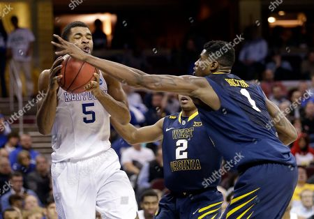 Andrew Harrison, Jonathan Holton West Virginia's Jonathan Holton (1) swats the ball away from Kentucky's Andrew Harrison (5) in the second half of a college basketball game in the NCAA men's tournament regional semifinals, in Cleveland
