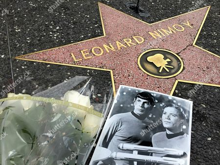 """Leonard Nimoy Flowers adorn the Hollywood Walk of Fame star of Leonard Nimoy in Los Angeles . Nimoy, famous for playing officer Mr. Spock in """"Star Trek"""" died Friday, Feb. 27, 2015 in Los Angeles of end-stage chronic obstructive pulmonary disease. He was 83"""
