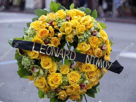 """A memorial wreath of flowers stands on the Hollywood Walk of Fame star of actor, Leonard Nimoy, in Los Angeles, . Nimoy, famous for playing officer Mr. Spock in """"Star Trek"""" died Friday, Feb. 27, 2015, in Los Angeles, of end-stage chronic obstructive pulmonary disease. He was 83"""