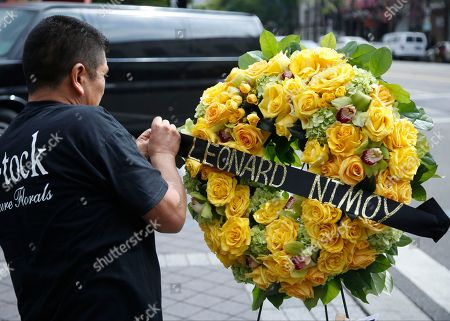 """Leonard Nimoy A florist sets memorial flowers on the Hollywood Walk of Fame star of actor Leonard Nimoy in Los Angeles, . Nimoy, famous for playing officer Mr. Spock in """"Star Trek"""" died Friday, Feb. 27, 2015, in Los Angeles of end-stage chronic obstructive pulmonary disease. He was 83"""