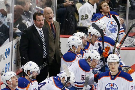 Todd Nelson, Craig Ramsay Edmonton Oilers head coach Todd Nelson, left rear, and assistant Craig Ramsay stand behind their bench during the third period of an NHL hockey game against the Pittsburgh Penguins in Pittsburgh . The Penguins won 6-4
