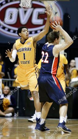 Cameron Payne, Reece Chamberlain Murray State guard Cameron Payne (1) defends Belmont guard Reece Chamberlain (22) during the first half of an NCAA college basketball game in the final of the Ohio Valley Conference tournament, in Nashville, Tenn