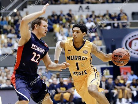 Cameron Payne, Reece Chamberlain Murray State guard Cameron Payne (1) drives against Belmont guard Reece Chamberlain (22) during the first half of an NCAA college basketball game in the final of the Ohio Valley Conference tournament, in Nashville, Tenn