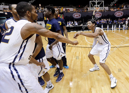 Cameron Payne, T.J. Sapp Murray State guard Cameron Payne, right, dances with T.J. Sapp (22), left, after Murray State defeated Morehead State 80-77 in an NCAA college basketball game in the semifinals of the Ohio Valley Conference tournament, in Nashville, Tenn