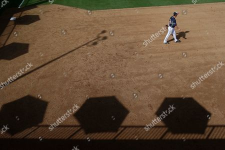 Minnesota Twins shortstop James Beresford (30) walks across a practice field before an exhibition spring training baseball game against the Tampa Bay Rays, in Fort Myers Fla