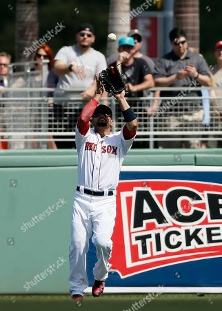 Shane Victorino Boston Red Sox's Shane Victorino reaches up to grab a fly out by Miami Marlins' Jeff Baker in the third inning of a spring training baseball game in Fort Myers Fla