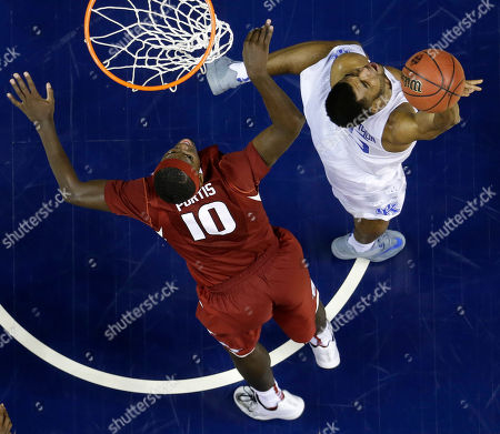 Kentucky guard Andrew Harrison (5) and Arkansas forward Bobby Portis (10) vie for a rebound during the second half of the NCAA college basketball Southeastern Conference tournament championship game, in Nashville, Tenn. Kentucky won 78-63
