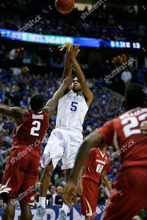 Kentucky guard Andrew Harrison (5) shoots on Arkansas forward Alandise Harris (2) during the second half of the NCAA college basketball Southeastern Conference tournament championship game, in Nashville, Tenn