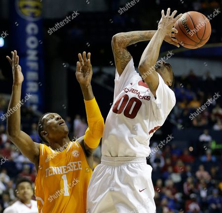 Arkansas guard Rashad Madden (00) runs into Tennessee guard Josh Richardson (1) during the first half of an NCAA college basketball game in the quarterfinal round of the Southeastern Conference tournament, in Nashville, Tenn