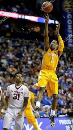 Tennessee guard Josh Richardson (1) shoots over Arkansas guard Anton Beard (31) during the second half of an NCAA college basketball game in the quarterfinal round of the Southeastern Conference tournament, in Nashville, Tenn