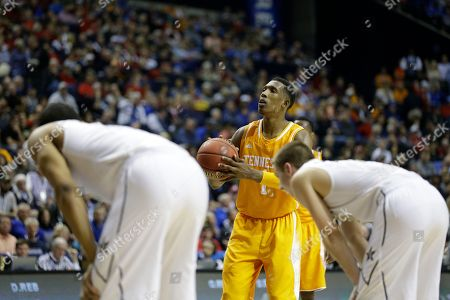 Tennessee guard Josh Richardson (1) shoots against Vanderbilt during the second half of an NCAA college basketball game in the second round of the Southeastern Conference tournament, in Nashville, Tenn