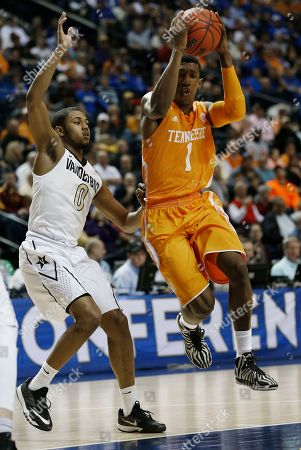 Tennessee guard Josh Richardson (1) jumps as Vanderbilt guard Shelton Mitchell (0) defends during the first half of an NCAA college basketball game in the second round of the Southeastern Conference tournament, in Nashville, Tenn