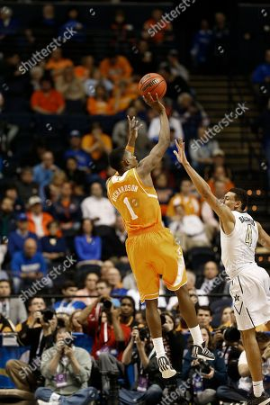 Tennessee guard Josh Richardson (1) shoots over Vanderbilt guard Wade Baldwin IV (4) during the second half of an NCAA college basketball game in the second round of the Southeastern Conference tournament, in Nashville, Tenn