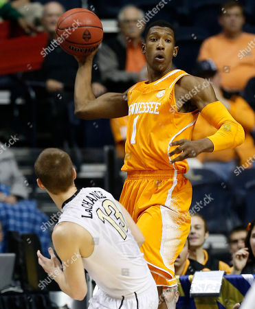 Tennessee guard Josh Richardson (1) passes the ball as Vanderbilt guard Riley LaChance (13) looks on during the first half of an NCAA college basketball game in the second round of the Southeastern Conference tournament, in Nashville, Tenn