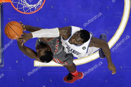 Daniel Ochefu, Khadim Ndiaye St. John's Khadim Ndiaye, left, tries to get a shot past Villanova's Daniel Ochefu during the second half of an NCAA college basketball game, in Philadelphia. Villanova won 105-68