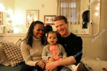 21-month-old Lena Renee Kready is flanked by her actor parents Jeff Kready, right, and Nikki Renee Daniels in the Walter Kerr Theatre in New York. The two married Broadway actors juggle their eight-show-a-week schedules with being first-time parents