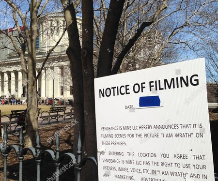 "This photo shows a sign displaying information regarding the filming of scenes for a John Travolta movie being shot inside the Ohio Statehouse, background, in Columbus, Ohio. On Wednesday, a fictional governor played by actor Patrick St. Esprit was filmed on the west steps of the Ohio Statehouse as part of the movie called ""I Am Wrath."" He was joined by more than 100 extras who stood for several hours in 45-degree weather for multiple takes. The crew was also scheduled to shoot inside the Statehouse"