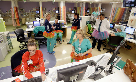 Nurses and office personnel wear their tutus at the nursing station at Joe DiMaggio Children's Hospital in Hollywood, Fla., Tuesday, March 24, 2015