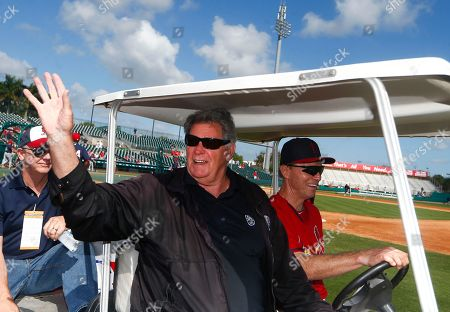 St. Louis Cardinals board caster and former player Mike Shannon waves to the fans before an exhibition spring training baseball game against the Minnesota Twins, in Jupiter, Fla