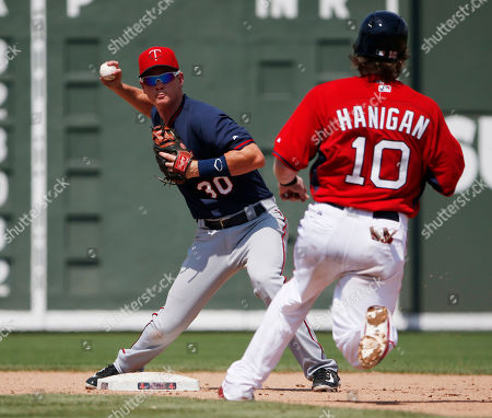 James Beresford, Ryan Hanigan Minnesota Twins' shortstop James Beresford (30) forces out Boston Red Sox' catcher Ryan Hanigan (10) at second base and throws to first for a double play in the sixth inning during an exhibition spring training baseball game, in Fort Myers, Fla