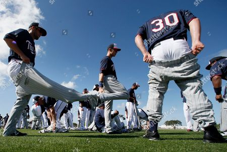 James Beresford Minnesota Twins' James Beresford (30) and other position players put on old trousers as they prepare to participate in sliding drills at baseball spring training in Fort Myers, Fla