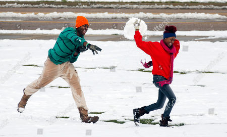 Tyler Reed, Lacey Reed Tyler Reed, left, gives some brotherly love to his sister Lacey as he hits her with a large snowball on the Mississippi State University campus in Starkville, Miss., . Hazardous driving conditions continued over much of northern Mississippi Thursday as the remnants of a storm system lingered