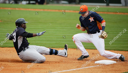 Jose Pirela, Colin Moran New York Yankees' Jose Pirela, left, beats the tag at third base by Houston Astros' Colin Moran after hitting a triple to score teammate Nick Noonan in the eighth inning of an exhibition spring training baseball game, in Kissimmee, Fla