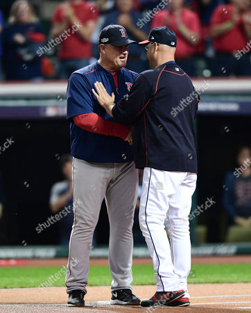 Boston Red Sox manager John Farrell, left, and Cleveland Indians manager Terry Francona greet each other before Game 1 of baseball's American League Division Series, in Cleveland