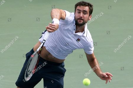 Croatia's Marin Cilic serves against Juan Monaco of Argentina during the quarterfinal match of Japan Open tennis championships in Tokyo