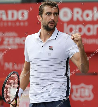 Croatia's Marin Cilic reacts after winning a first set against Juan Monaco of Argentina during the quarterfinal match of Japan Open tennis championships in Tokyo