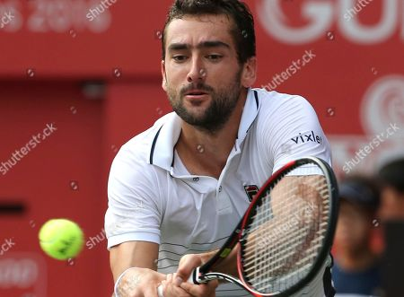 Croatia's Marin Cilic returns a shot against Juan Monaco of Argentina during the quarterfinal match of Japan Open tennis championships in Tokyo