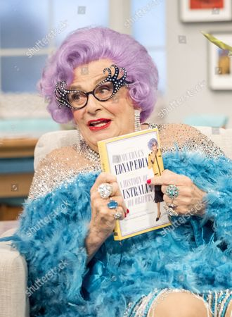 Dame Edna Everage with her new book 'EDNAPAEDIA: A History of Australia in 101 Objects'