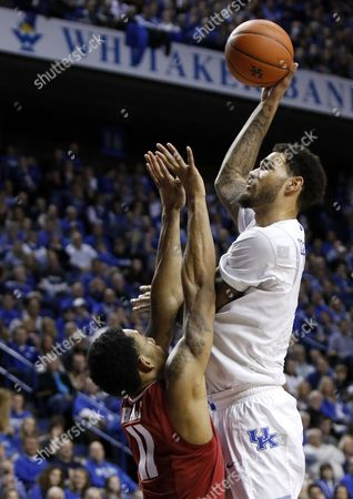 Willie Cauley-Stein, Shannon Hale Kentucky's Willie Cauley-Stein, right, shoots over Alabama's Shannon Hale during the second half of an NCAA college basketball game, in Lexington, Ky. Kentucky won 70-55