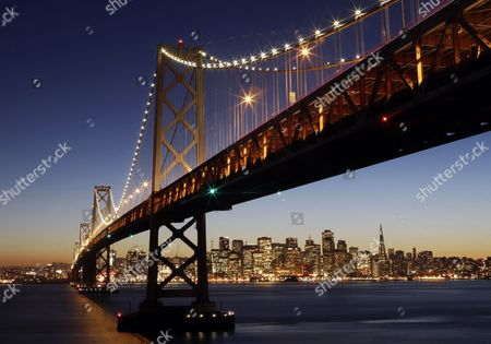 The San Francisco-Oakland Bay Bridge in San Francisco. Caltrans said the Bay Lights installation by artist Leo Villareal will permanently illuminate the western span of the bridge starting on January 30, when a re-lighting ceremony will be held just in time for the Super Bowl
